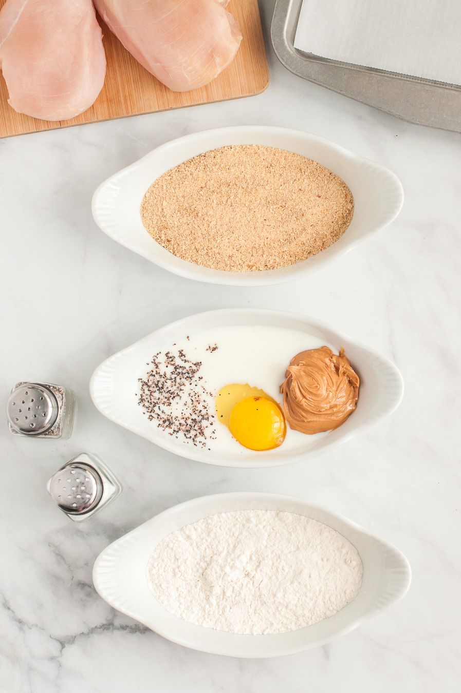 3 bowls for mixing, breadcrumbs and milk mixture.