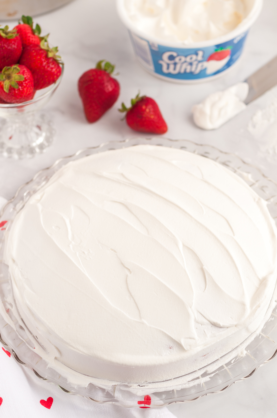 Cool Whip spread onto cake
