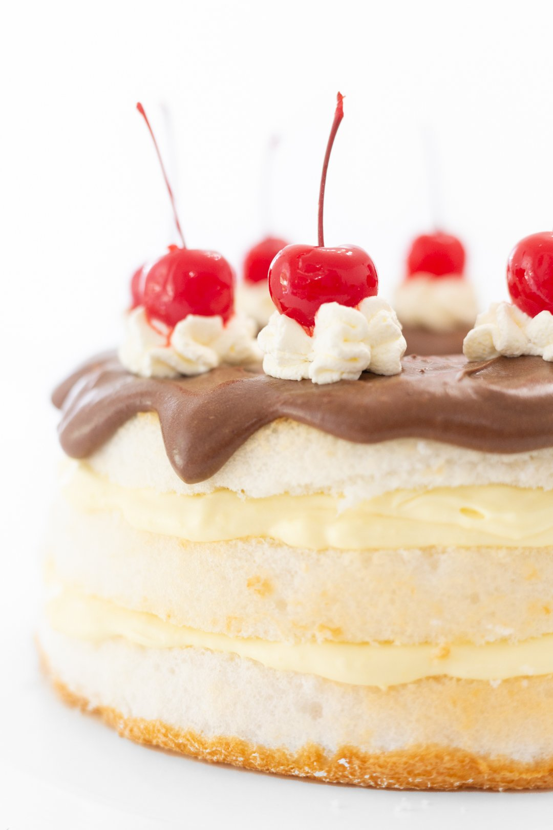 Easy Boston Cream Pie Cake Hack with Giant maraschino cherries. Yum.