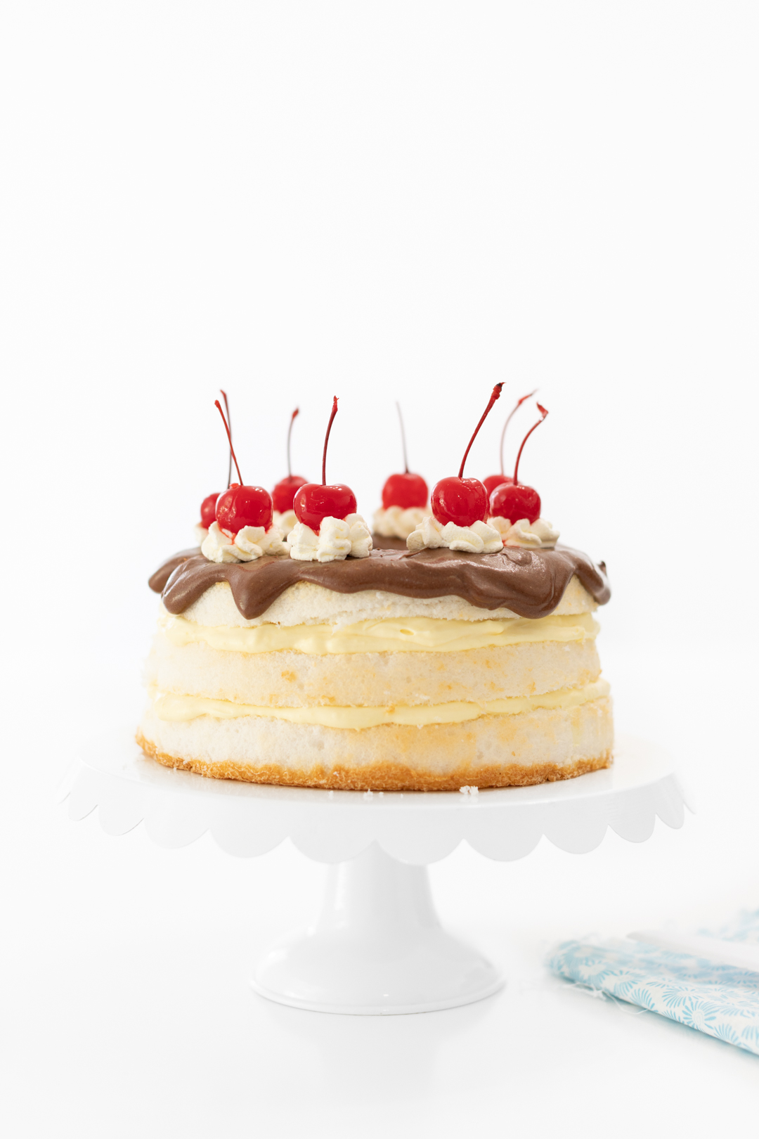 Boston Cream Pie That is Easy To Make. Topped with Cherries.