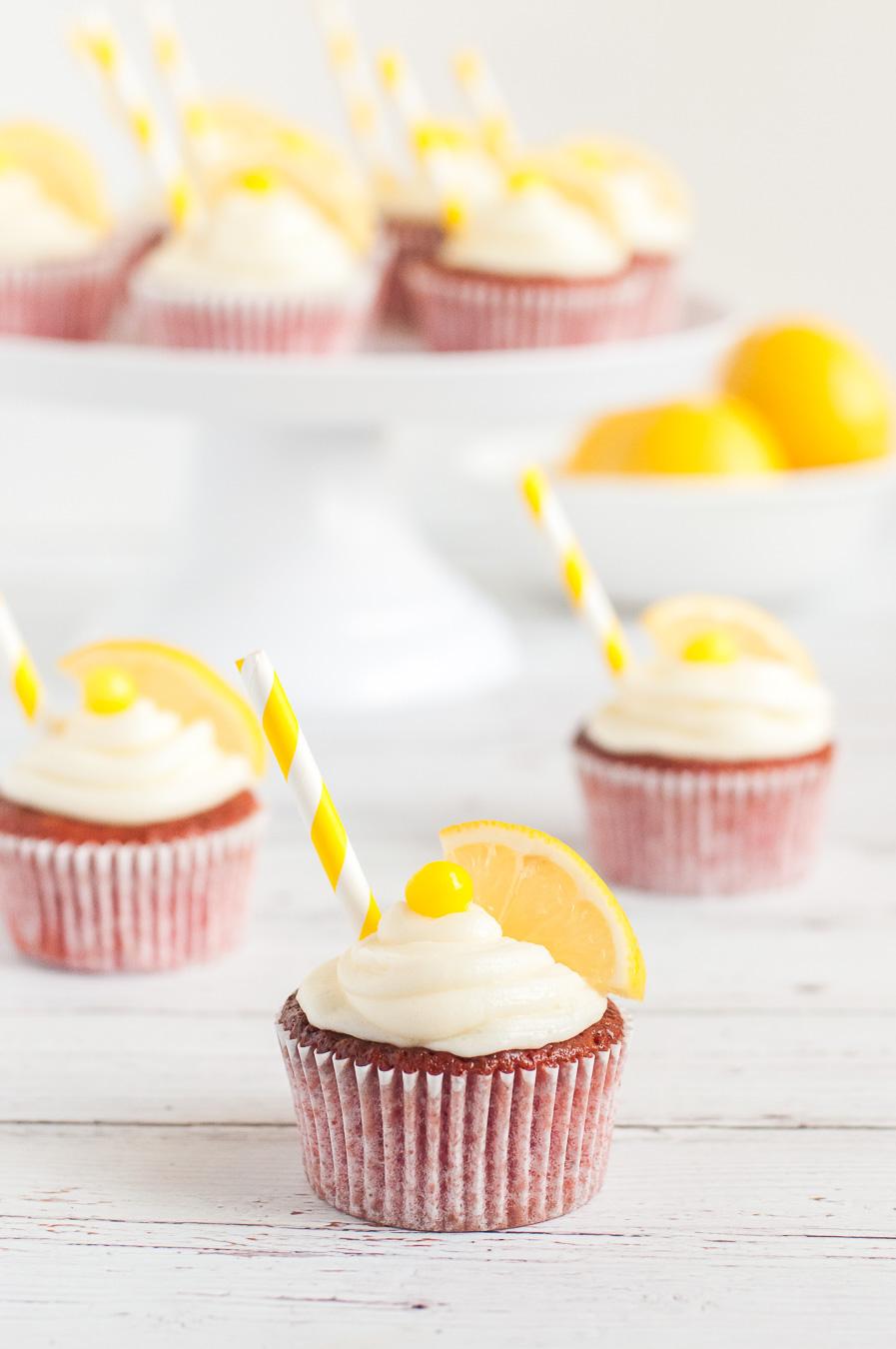 lemonade cupcakes on display with cake stand