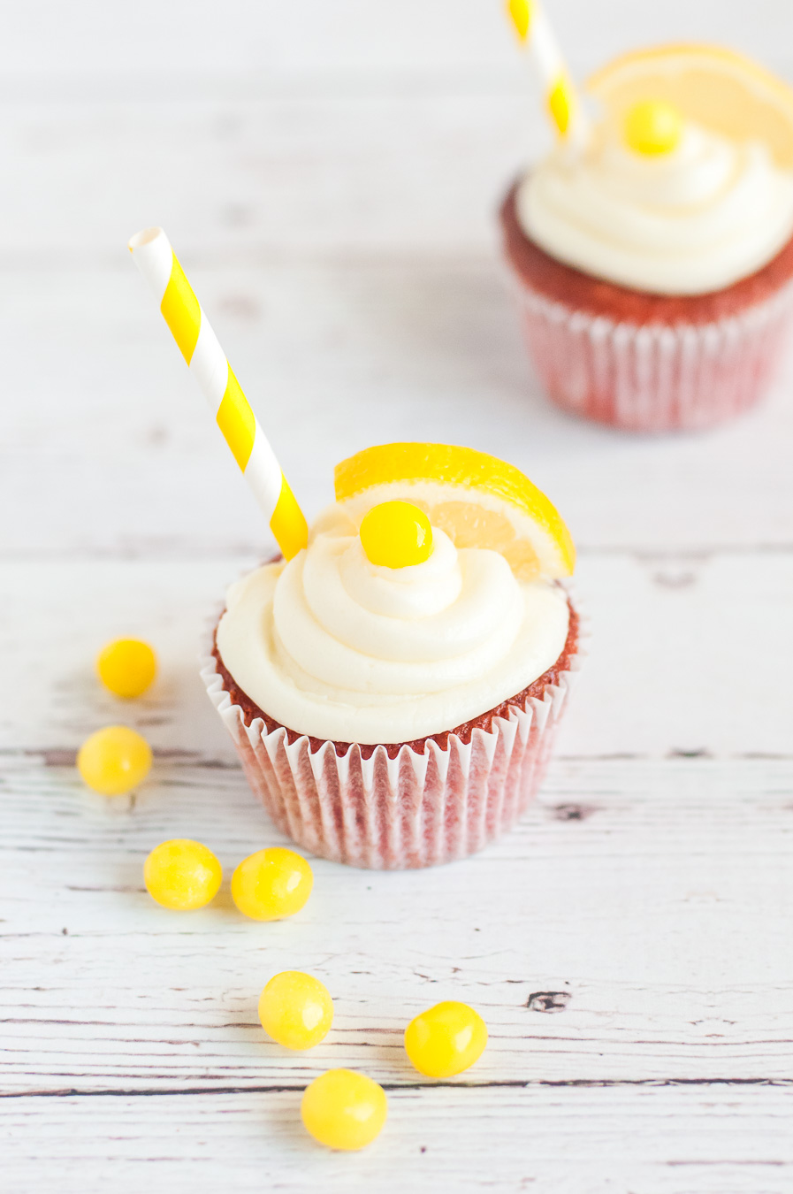 cute lemonade cupcakes with candy garnish and straws