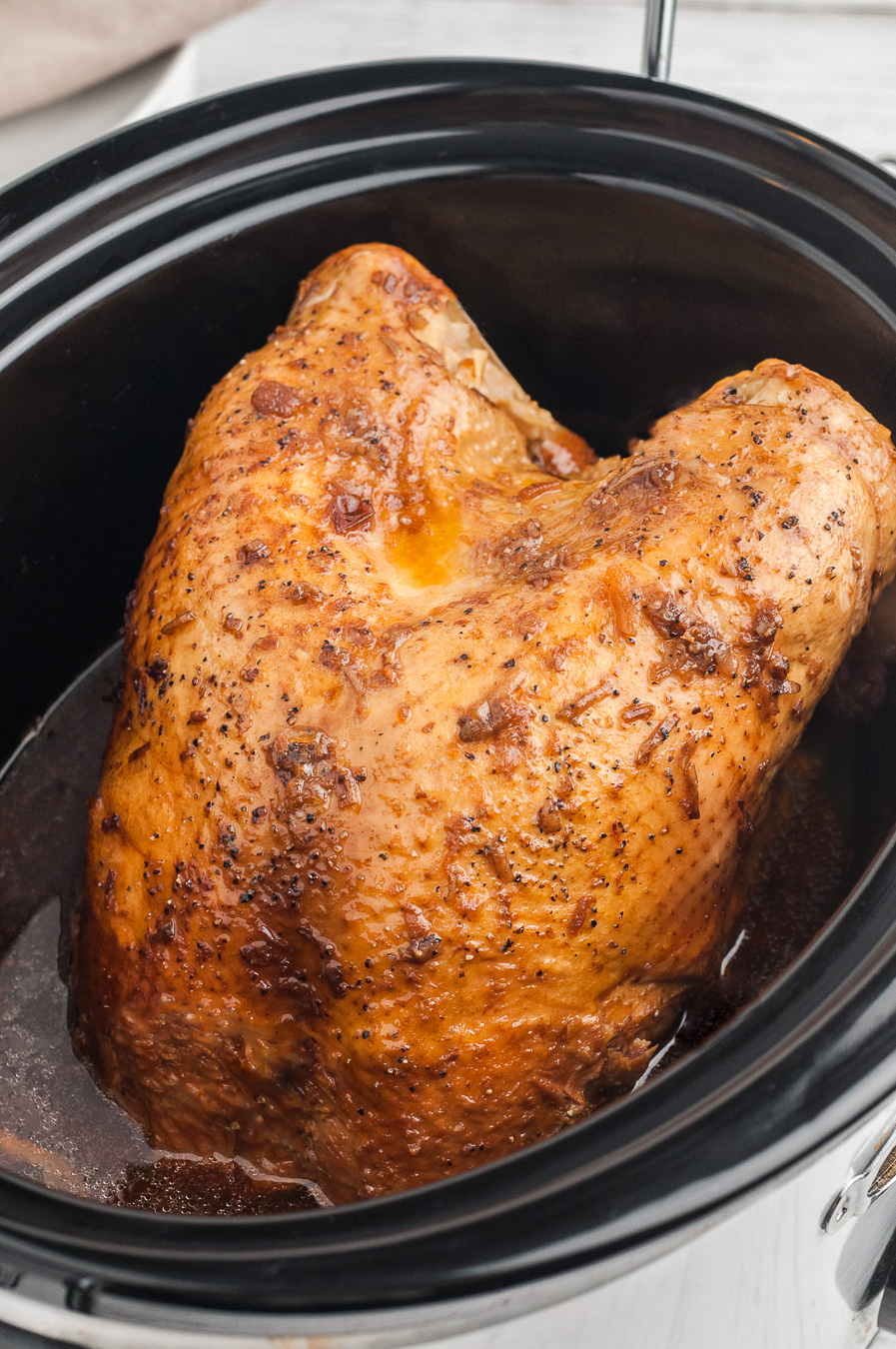 small turkey inside of a slow cooker