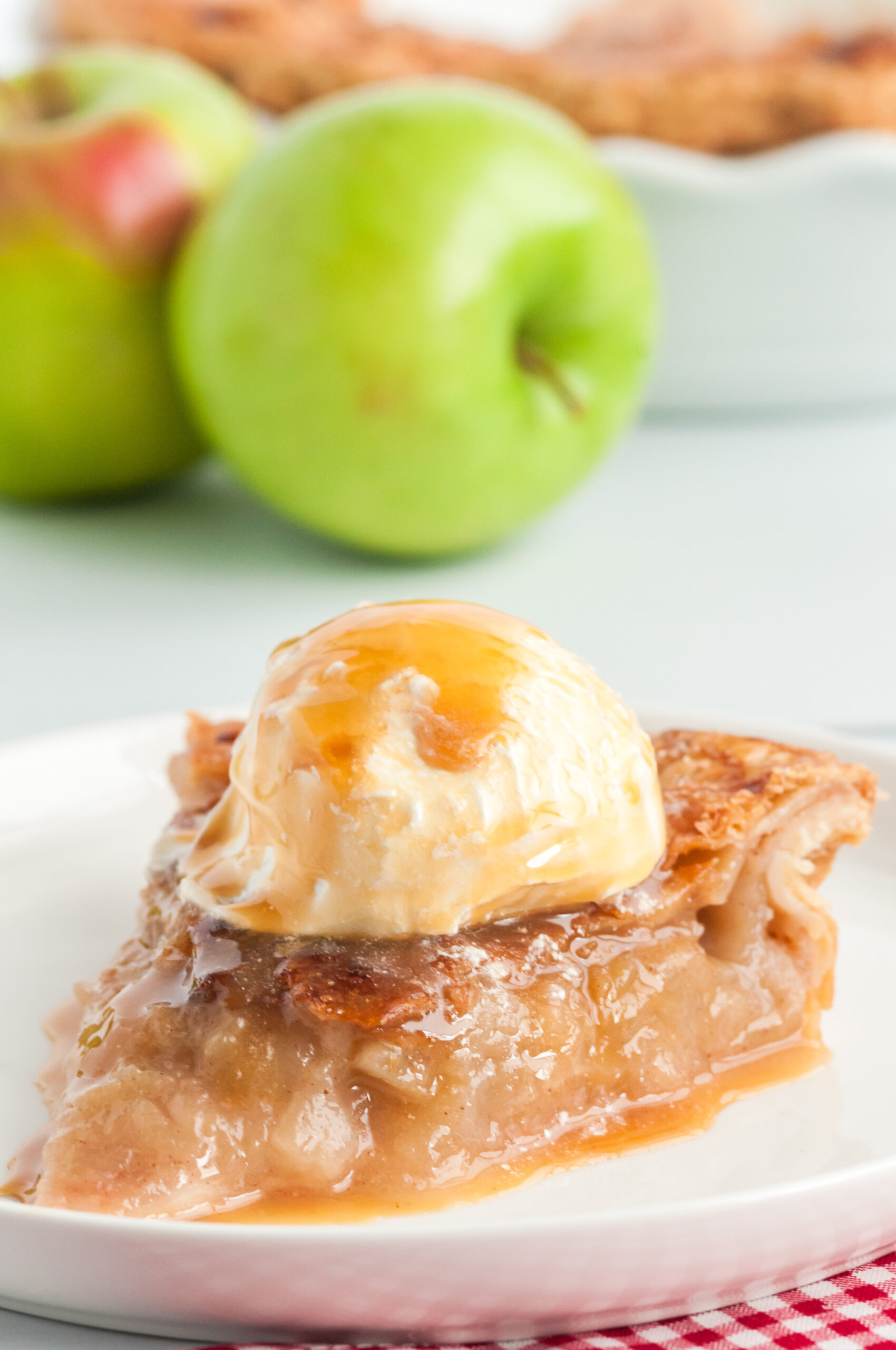 mouthwatering apple pie with caramel drizzled all over it.