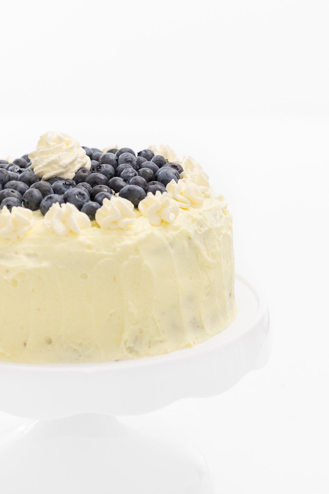 Simple lemon frosted cake with fresh blueberries.