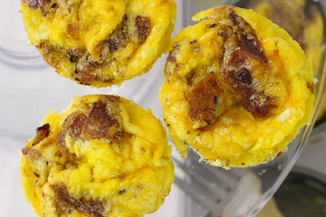 Breakfast quick fix favorite! Cheddar and Bacon made into adorable easy to make omelet cups. Nom.