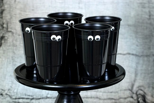 So spooky, so easy! Just slap on some sticky googly eyes for an easy Halloween party cup.