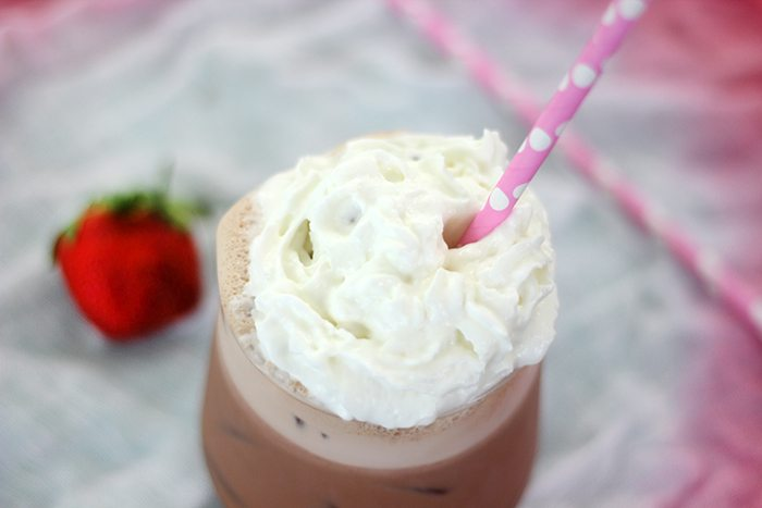 Craving a specialty coffee beverage? Make this super quick fix strawberries and cream iced coffee right at home with instant coffee.