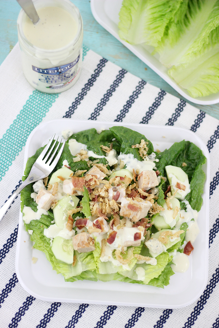Quick and easy dinner for summer! Make this Bleu Cheese, Chicken & Bacon Romaine Salad complete with the creamiest dressing and topped with fried onions. It's SO good!