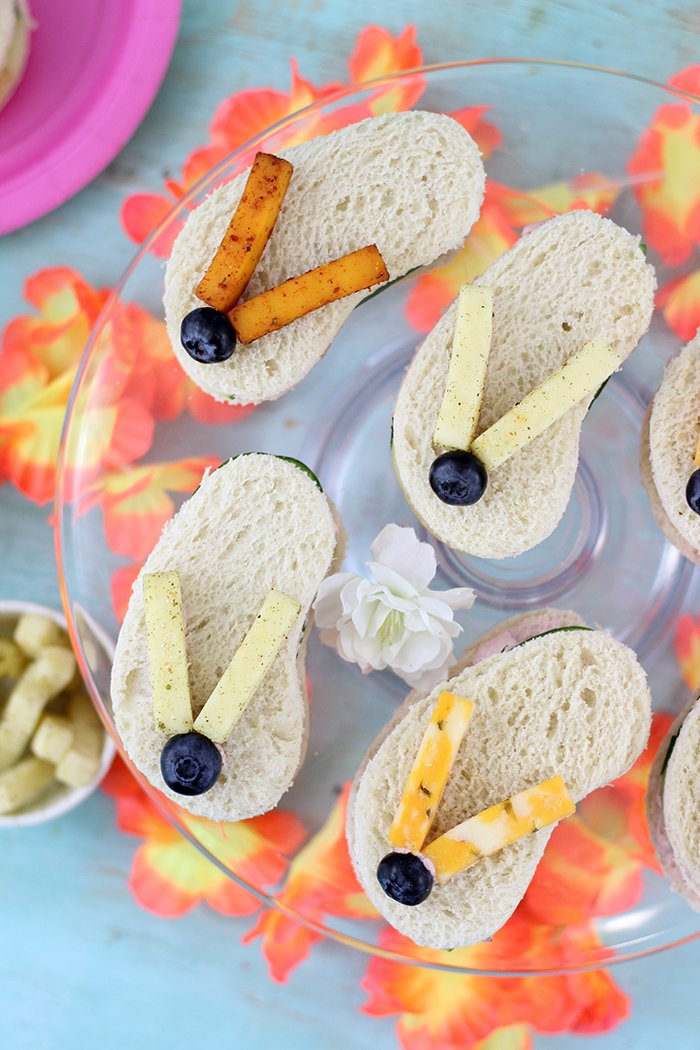 Flip Flop Sandwiches. So cute, great for summertime parties and beach parties. These are made with Sargento Cheese Snacks, Blueberries, Cucumbers and Strawberry Cream Cheese. Adorable!