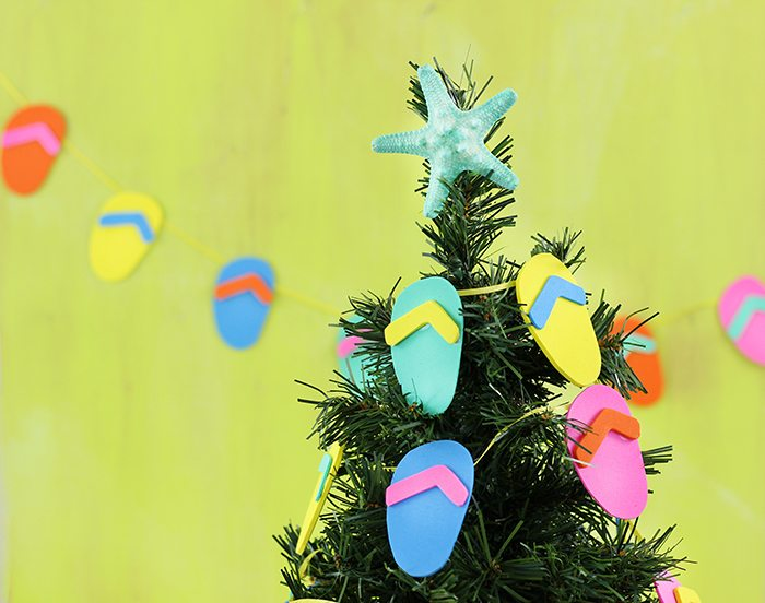 DIY Flip Flop Garland. Christmas in July? Make this fun craft that plays on a warm weather Christmas.