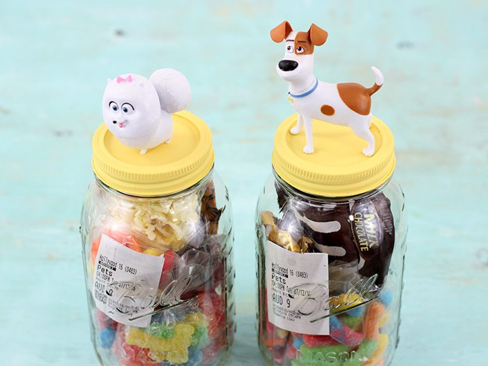 DIY Movie Invite In a Jar. Make movies even more special by inviting your guest with a jar filled with movie goodies and their ticket.