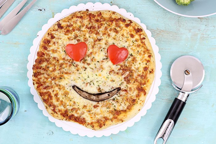 Smiley Face Veggie Pizza. Get your family smiling with these cute veggie emoticon pizza faces. From peppers. mushrooms, olives and broccoli you can get fun in the kitchen.