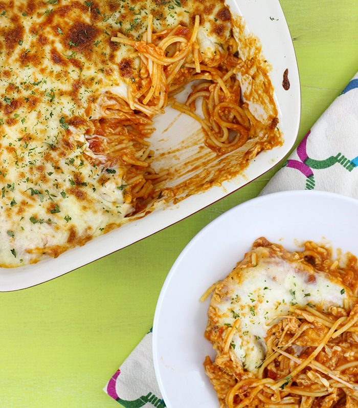 Cheesy Spaghetti Bake recipe comes together so quick and is SO cheesy and creamy. No joke. Perfect back to school recipe to add to your recipe box for sure.