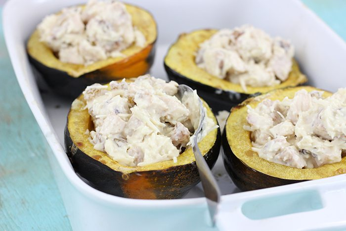 Chicken Alfredo Acorn Squash. Yummy way to reinvent dinner this fall. Cinnamon, Brown Sugar and Golden Raisins take this Dinner over the top.