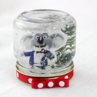 Snow Globes inspired by the SING movie. DIY project that you can do with kids.