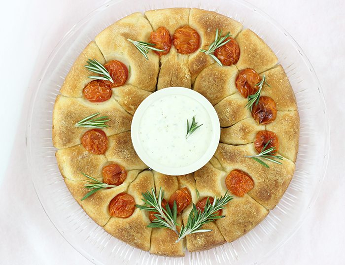 Ranch Dip Bread Wreath that's perfect for sharing this holiday season. So easy to make and delish to enjoy.