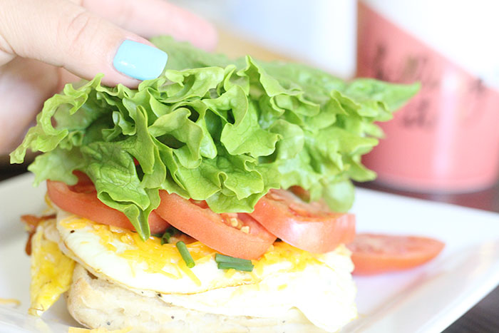 Tomato, Lettuce & Chive Breakfast Sandwich. Fresh eggs and cheese make this a surprising breakfast.