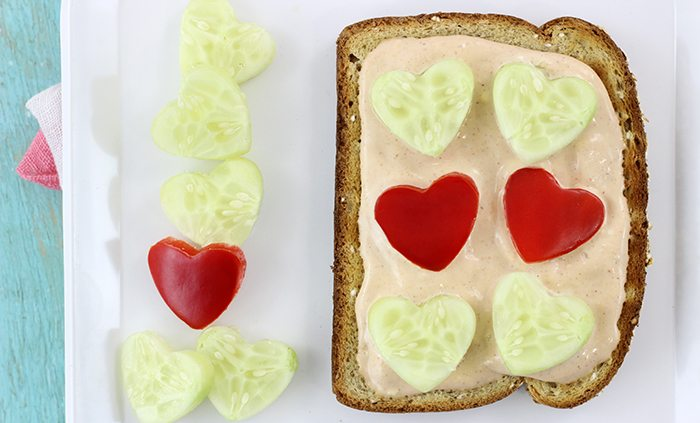 Veggie Valentine's Day Twist. Veggie Toasts with Cute Heart Shaped Veggies Served on Top.