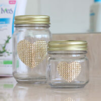Jar DIY Makeup Organizers with pretty gold rhinestone heart designs.