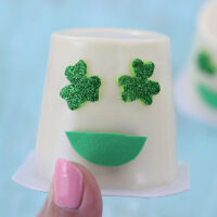 Shamrock Emoji Pudding Cups. Super cute craft idea to celebrate St. Patrick's Day.