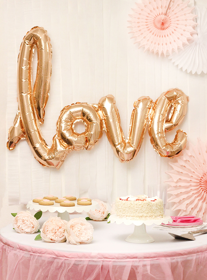 Mother's Day Party. Perfect Ice Cream Cake & Champagne and light pink decor. Pretty Mother's Day Party Ideas galore.