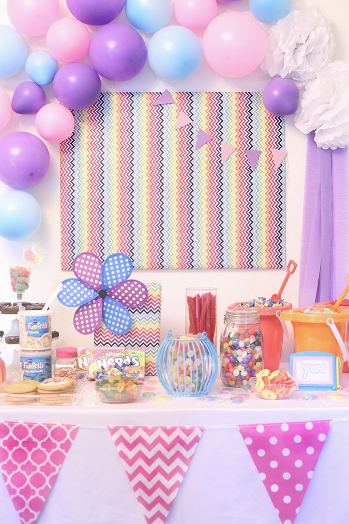 DIY Candy Buffet! Super easy and so fun. Use bright and whimsical colors to make it more magical.