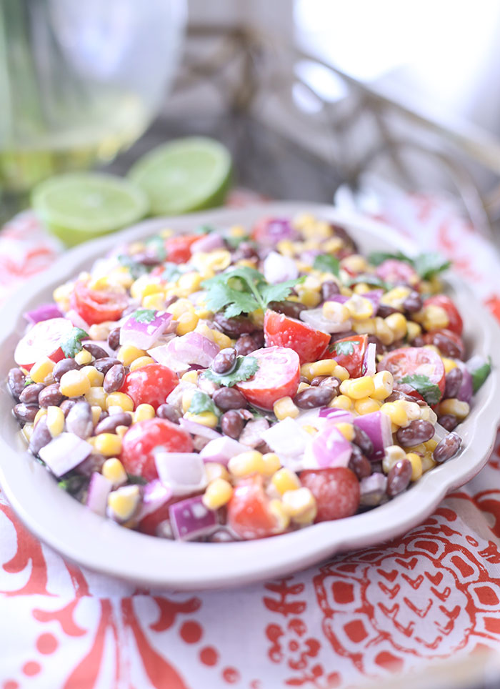Black Bean & Corn Salsa with a creamy lime dressing. SO easy and so fresh.