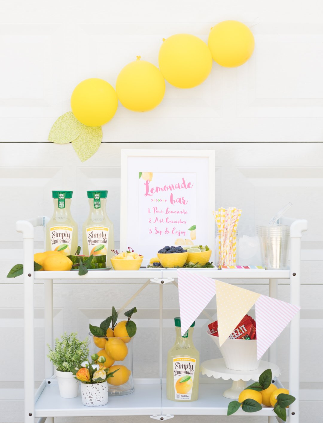 Lemonade Bar Cart Ideas. Best of summer all on one bar cart from lemonade to amazing garnishes.