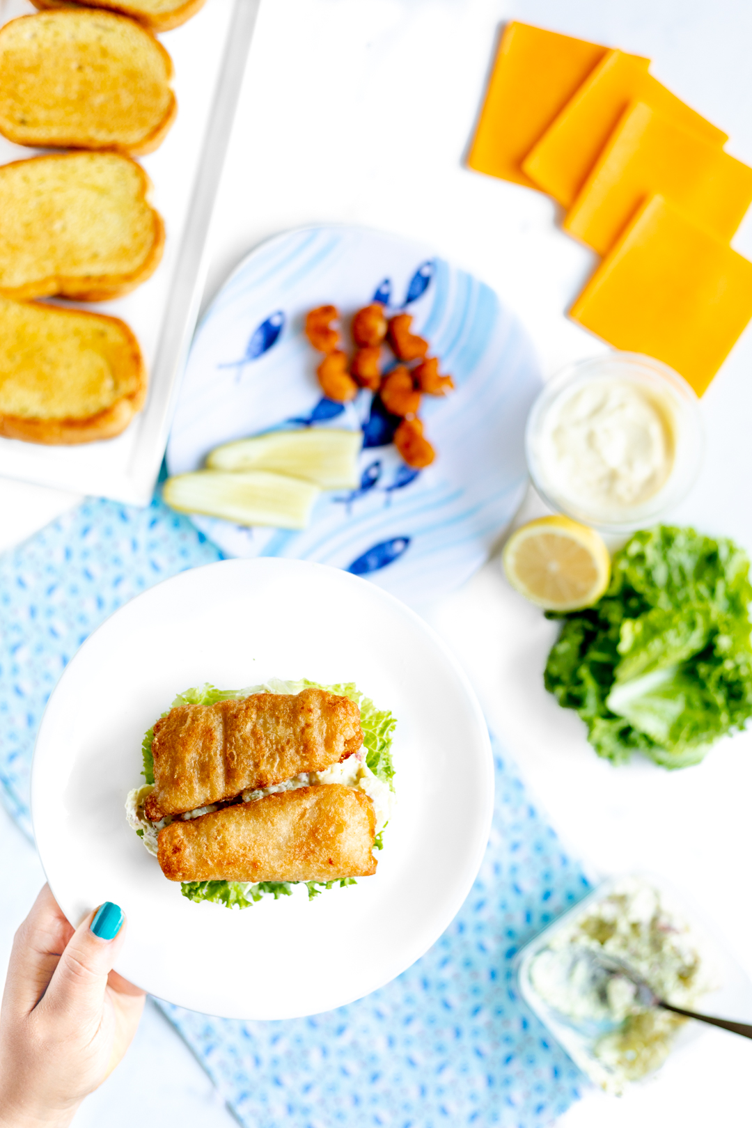 Easy Family Dinner. Over the top Fish Sandwiches made with red bliss potato salad and garlic mayo.