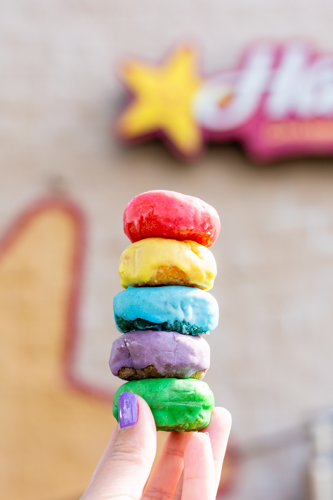 Froot Loop donuts exist and you need to get them at Hardees now before they are gone.
