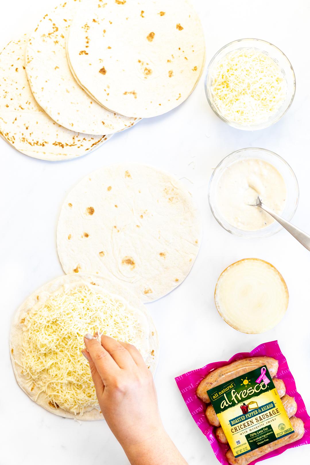 adding cheese to quesadillas