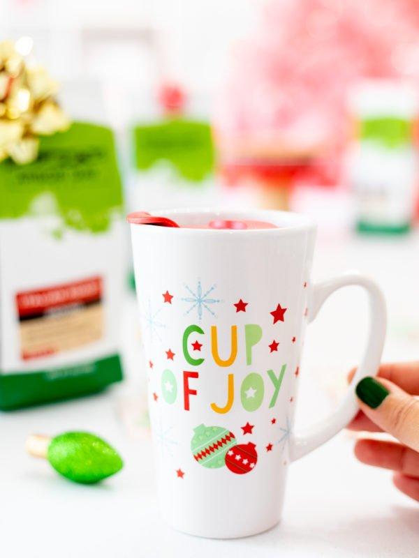 Girl Holding Cup of Joy Travel Mug
