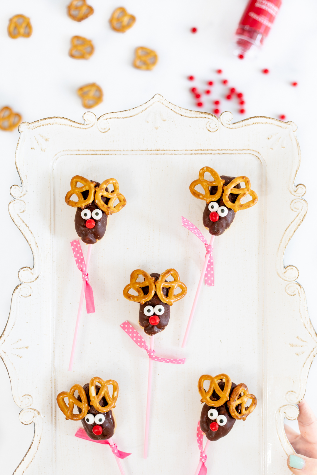 Reindeer lollipops on a tray.