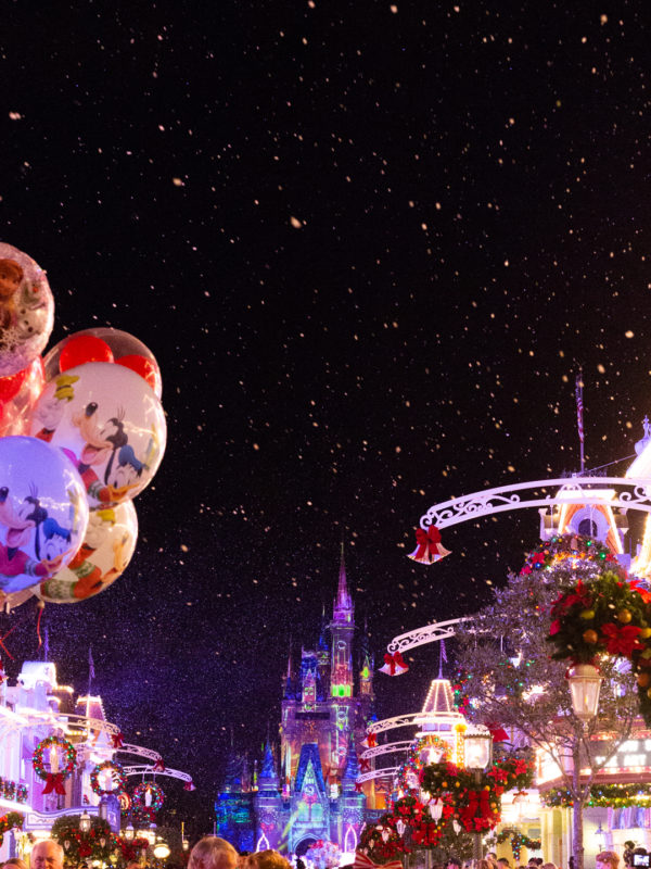 Disney Christmas Balloons on a snowy Main Street