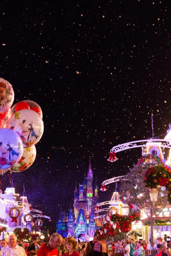 Disney Christmas Balloons on a snowy Main Street