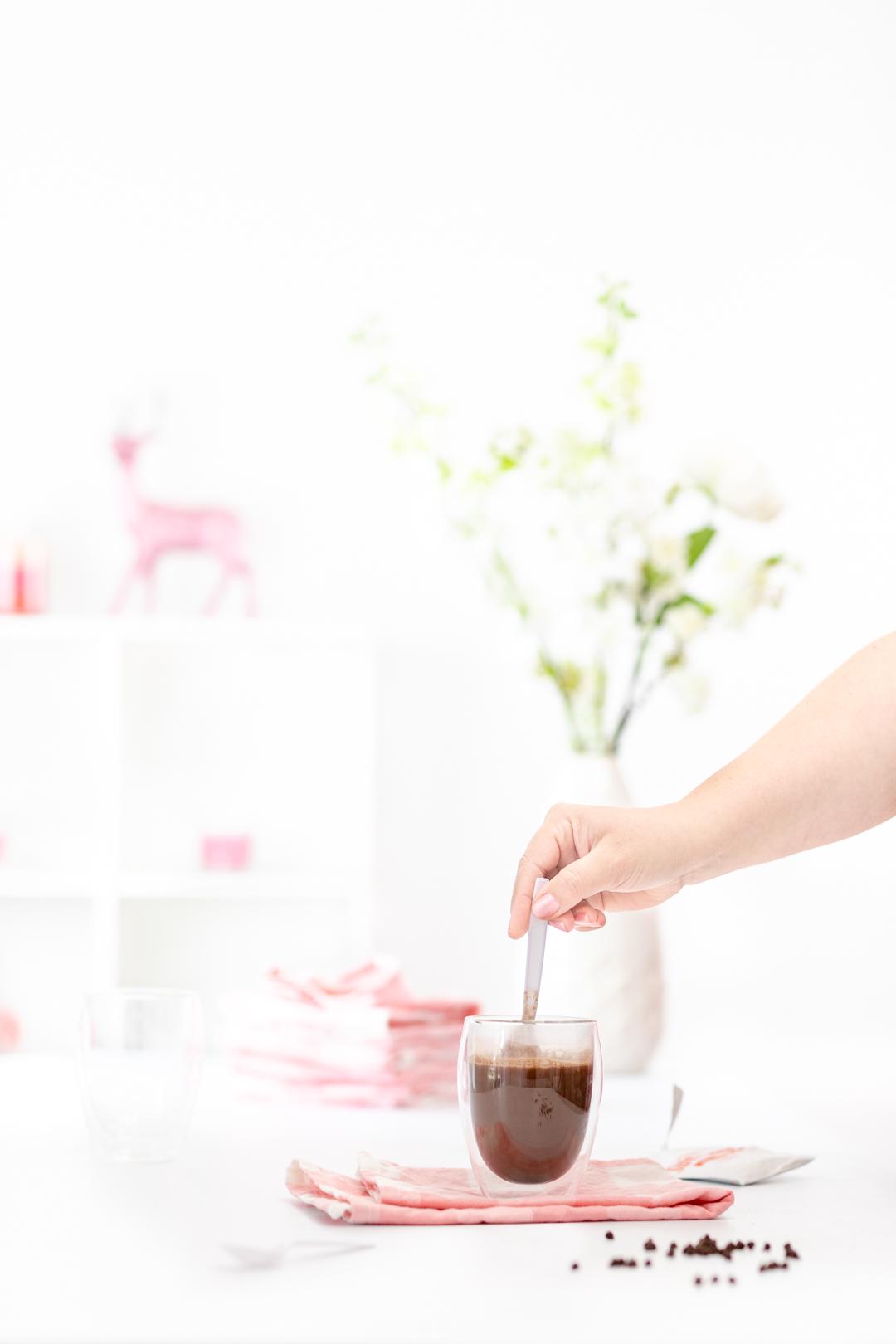 Stirring a mug of hot cocoa