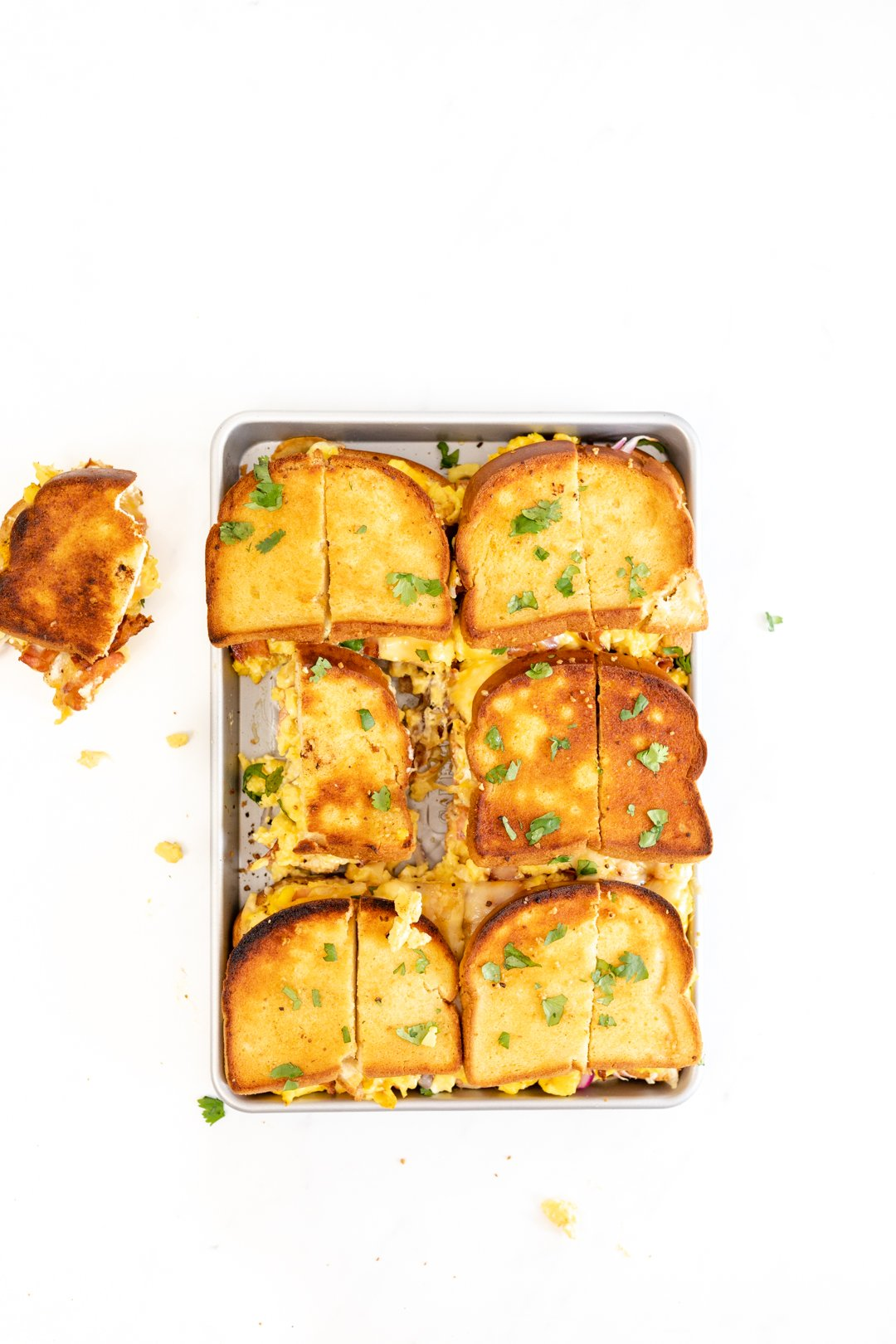 Toasted sandwiches on a baking sheet