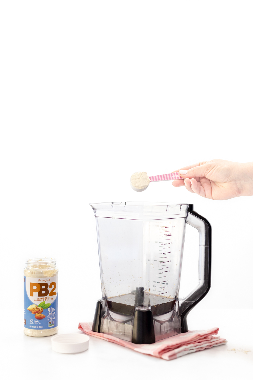 adding powdered almond butter to blender