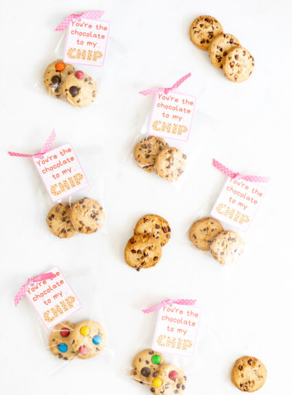 Printable Valentine Cards spread out with ribbons and more cookies