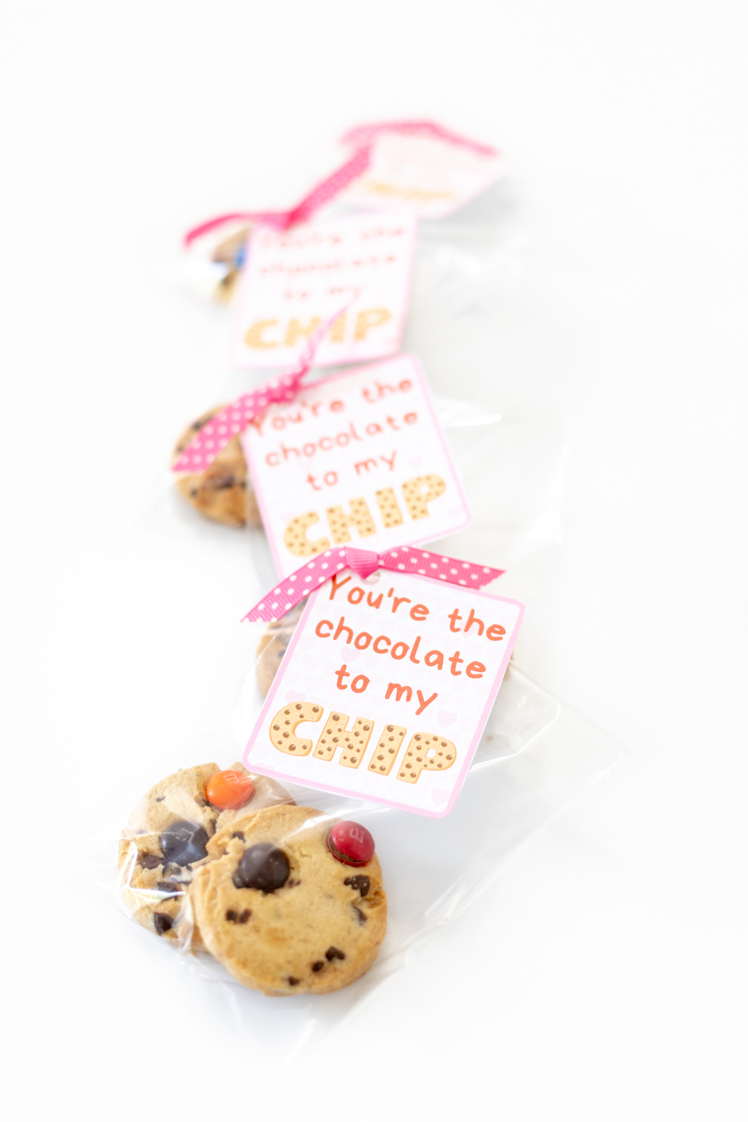diy packages of cookies for valentine's day with pretty ribbon