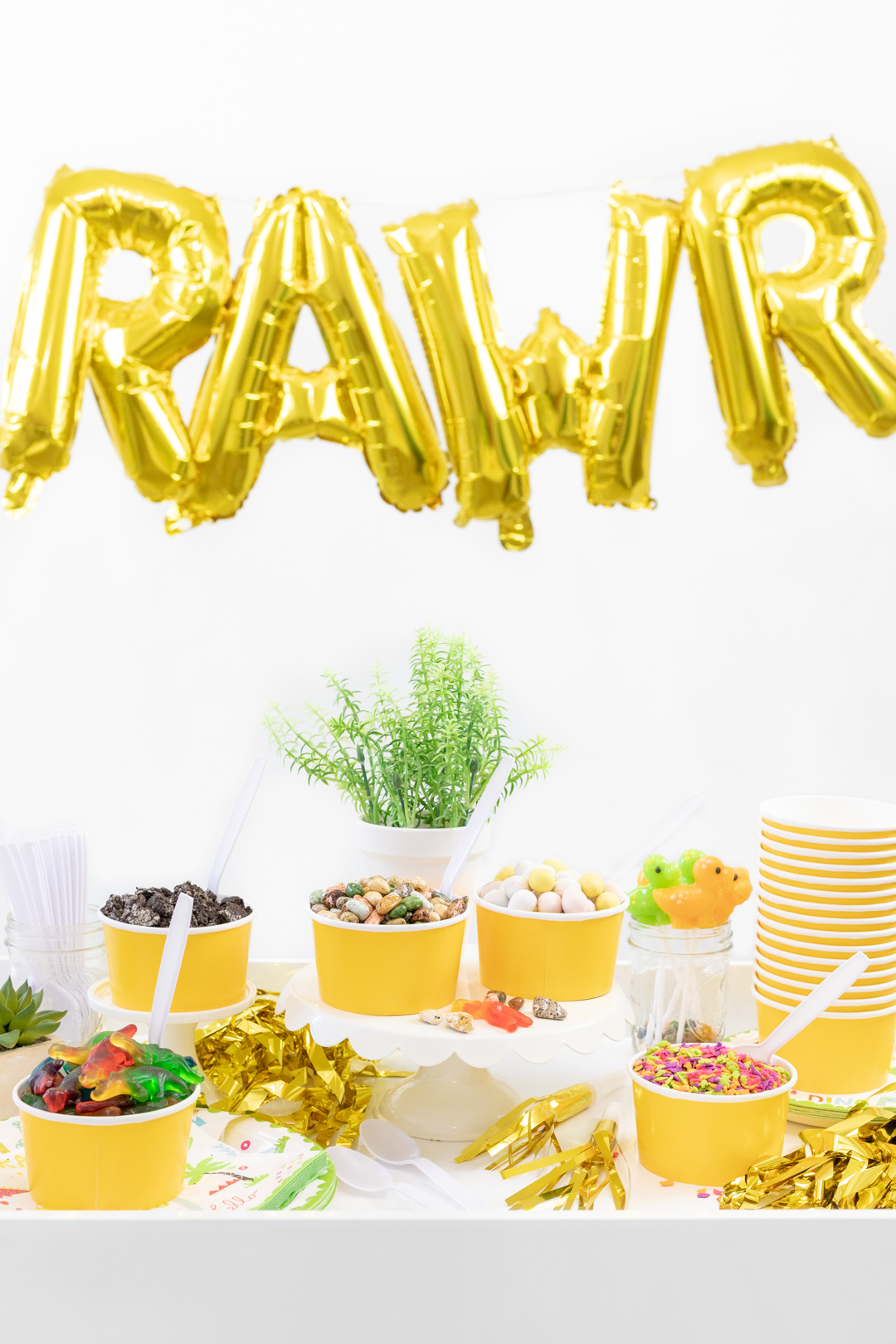 Rawr letter balloon with ice cream toppings with a dinosaur theme