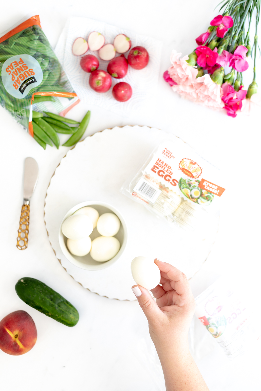 Boiled eggs, snap peas, mini cucumbers and radishes