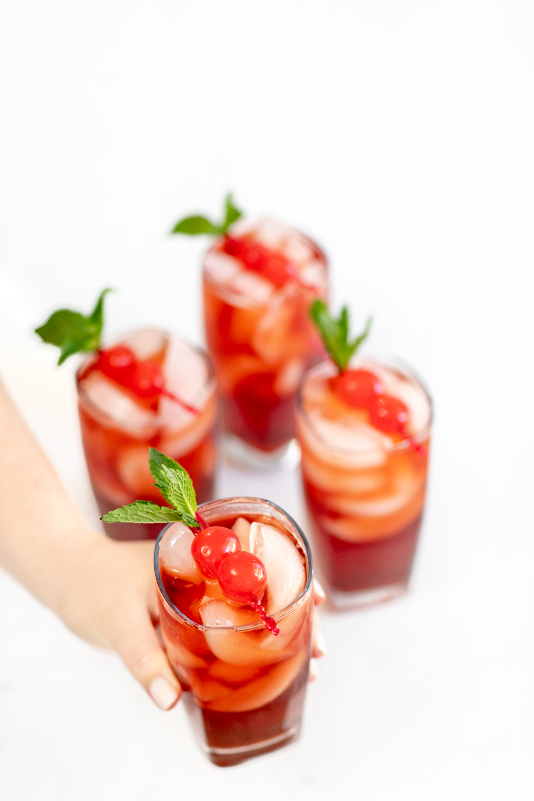 Iced tea with cherries and mint