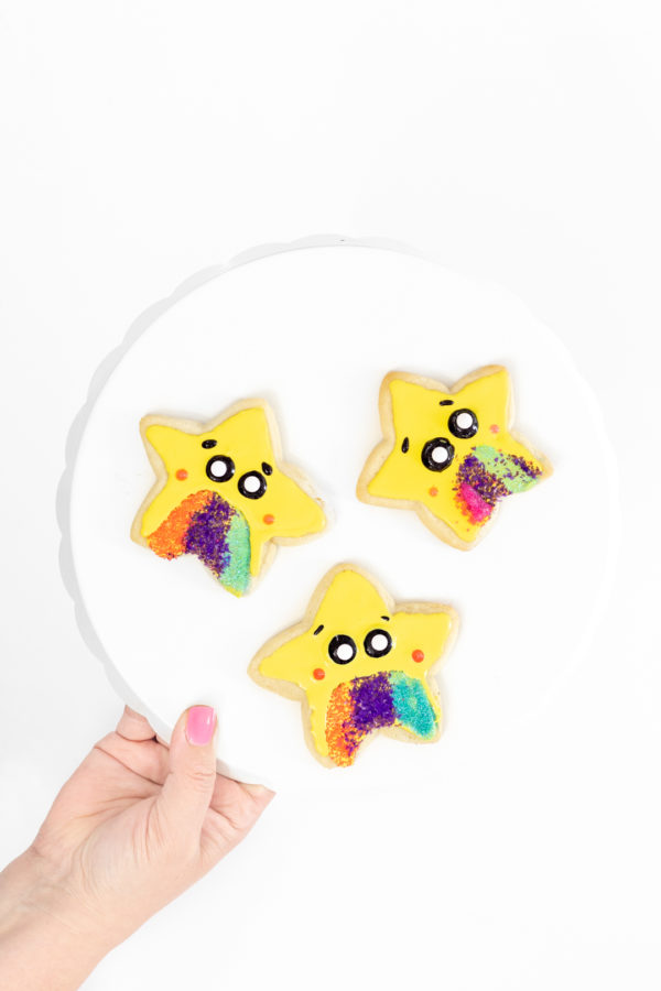 star cookies with yellow icing and colorful sprinkles