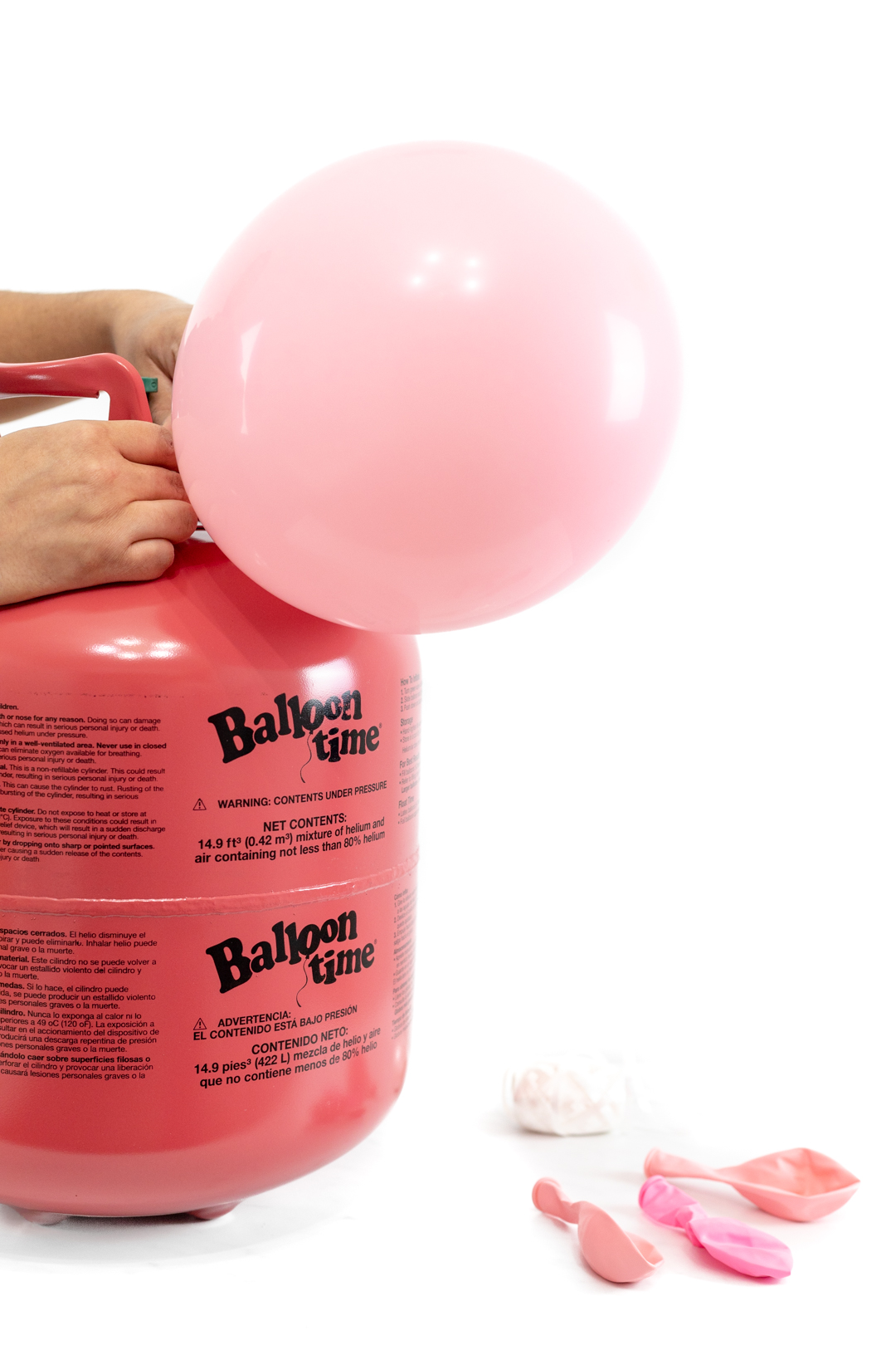 Balloon Time Tank with pink balloon getting inflated for party.