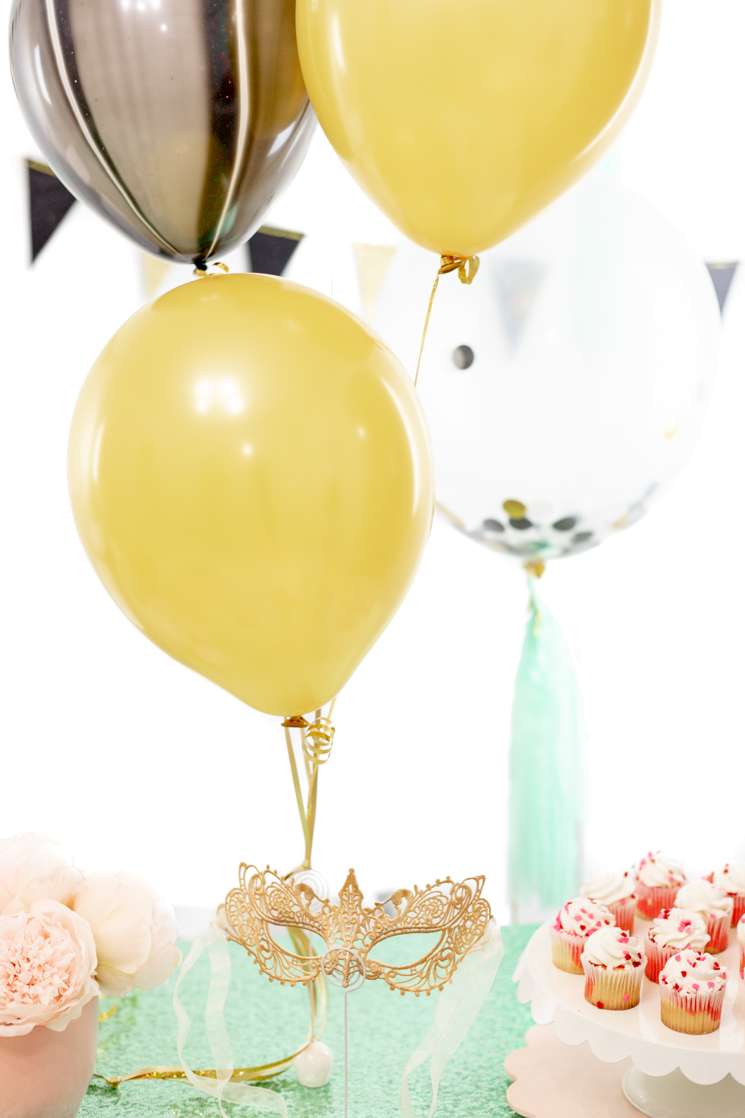 gold, black and teal balloons