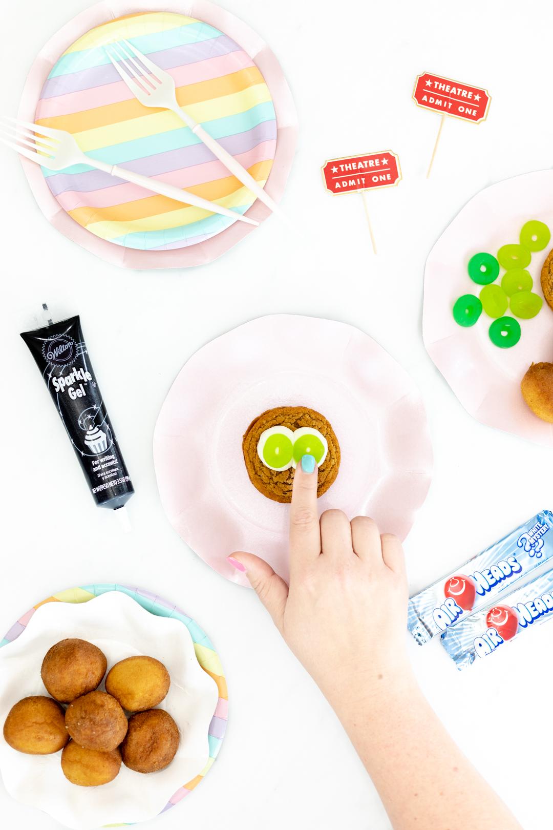 putting lifesaver gummies as eyes for cookies