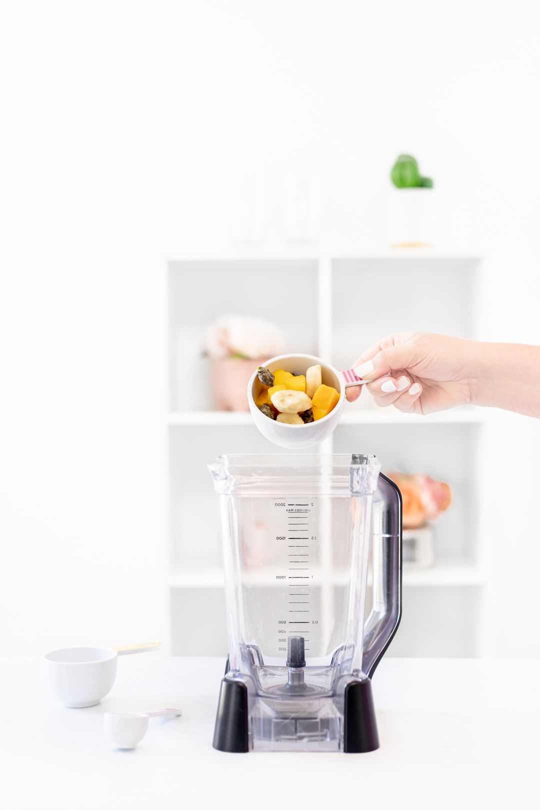 pouring fruit into blender