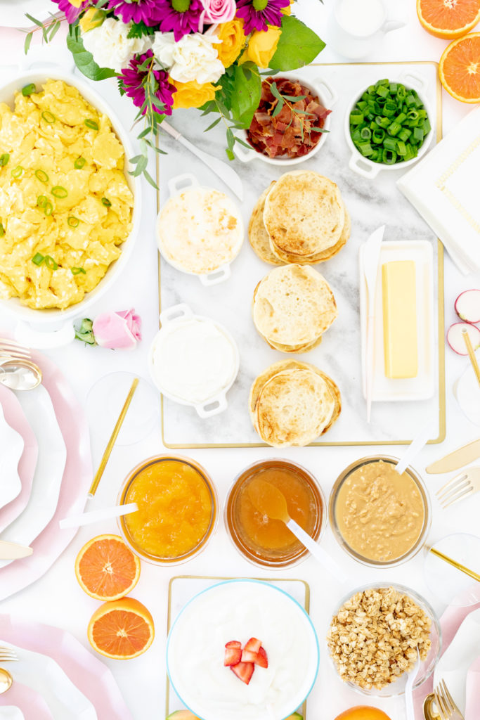 brunch spread with eggs, english muffins, spreads